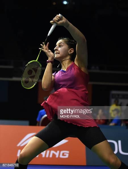 Carolina Marin of Spain returns a shot against Akane ...