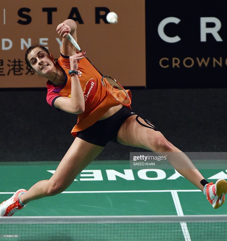Carolina Marin of Spain returns a shot to China s Wang Shixian
