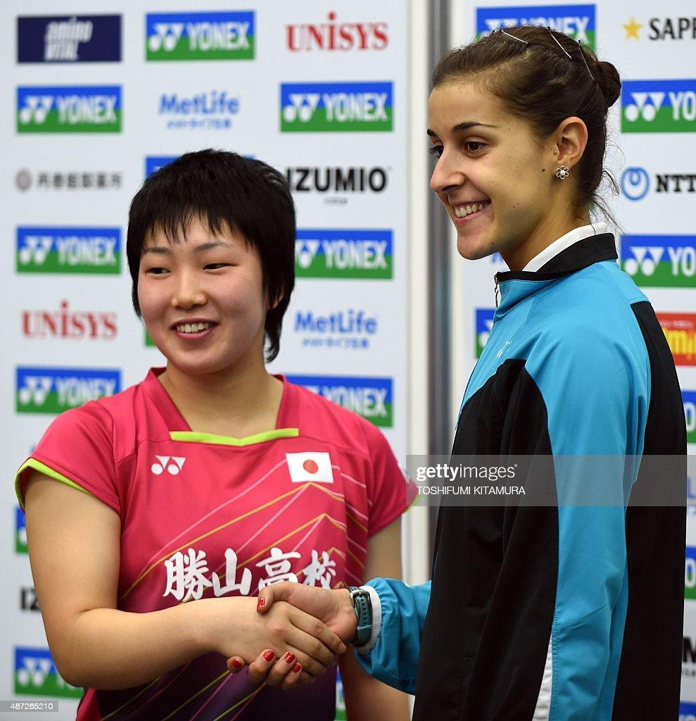 Carolina Marin of Spain R shakes hands with Akane Yamaguchi of
