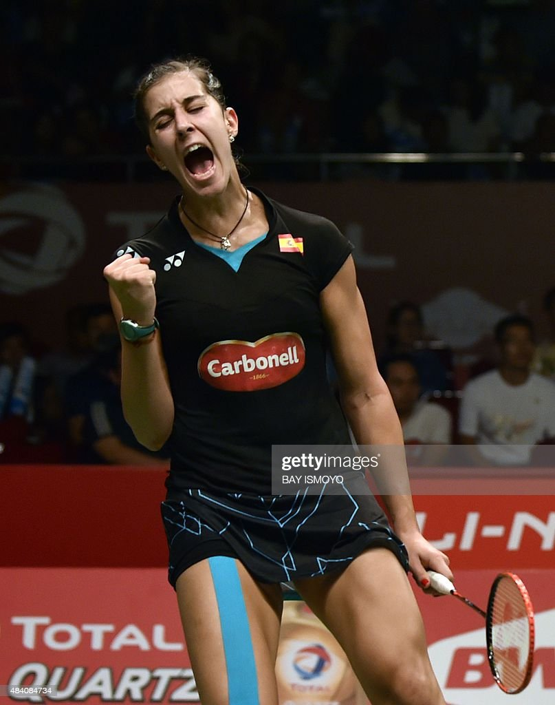 Carolina Marin of Spain shouts and gestures against Sung Ju Hyun