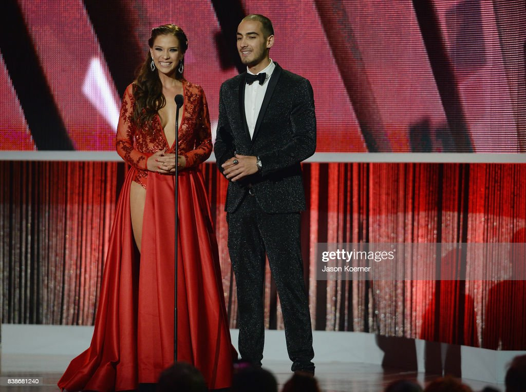 http://media.gettyimages.com/photos/carolina-miranda-and-michel-duval-on-stage-at-telemundos-2017-premios-picture-id838681240