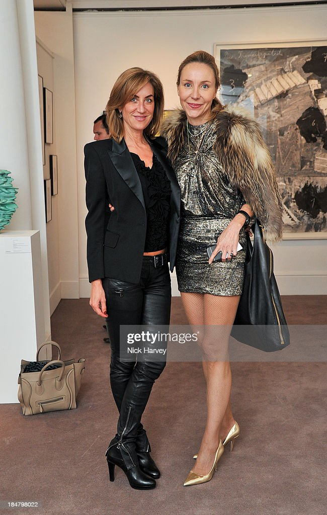 Carolina Muller Mohl and Michaela De Pury attend Mimi Foundation 'The Power of Love' gala dinner and auction at Sotheby's on October 16, 2013 in London, England.