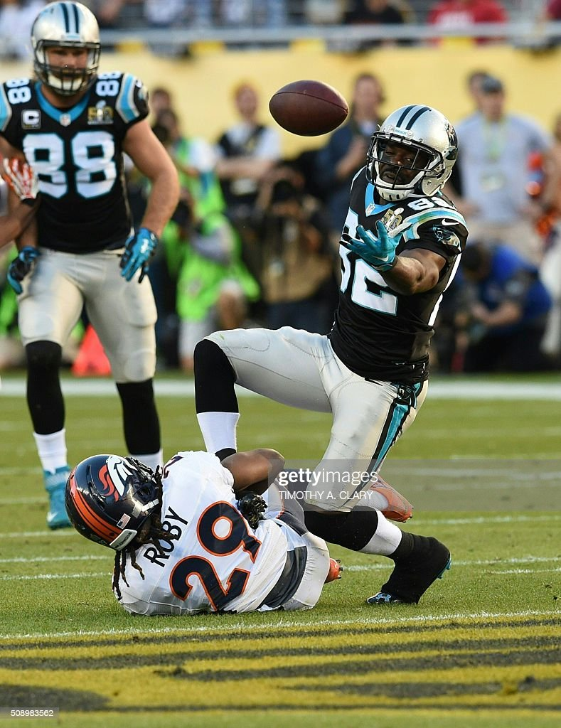 Carolina Panther Jerricho Cotchery is tackled by Denver Bronco Bradley Roby (29) during Super Bowl 50 at Levi's Stadium in Santa Clara, California, on February 7, 2016. / AFP / TIMOTHY A. CLARY