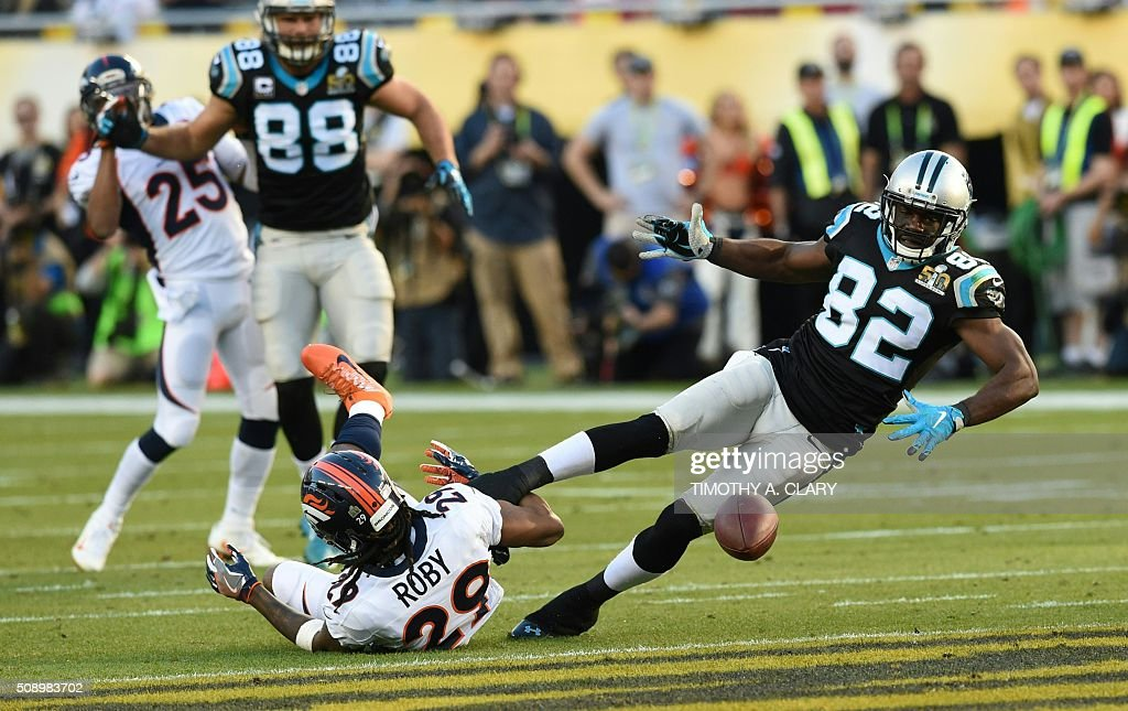 Carolina Panther Jerricho Cotchery (82) is tackled by Denver Bronco Bradley Roby (29) during Super Bowl 50 at Levi's Stadium in Santa Clara, California, on February 7, 2016. / AFP / TIMOTHY A. CLARY