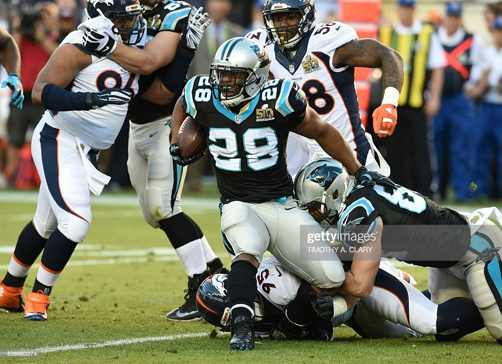 Carolina Panther Jonathan Stewart gets tackled during Super Bowl 50 against the Denver Broncos at Levi's Stadium in Santa Clara, California, on February 7, 2016. / AFP / TIMOTHY A. CLARY