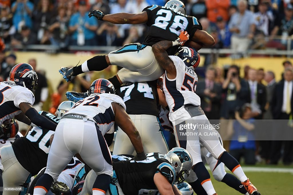Carolina Panther Jonathan Stewart (28) jumps into the end zone for a touchdown during Super Bowl 50 against the Denver Broncos at Levi's Stadium in Santa Clara, California, on February 7, 2016. / AFP / TIMOTHY A. CLARY