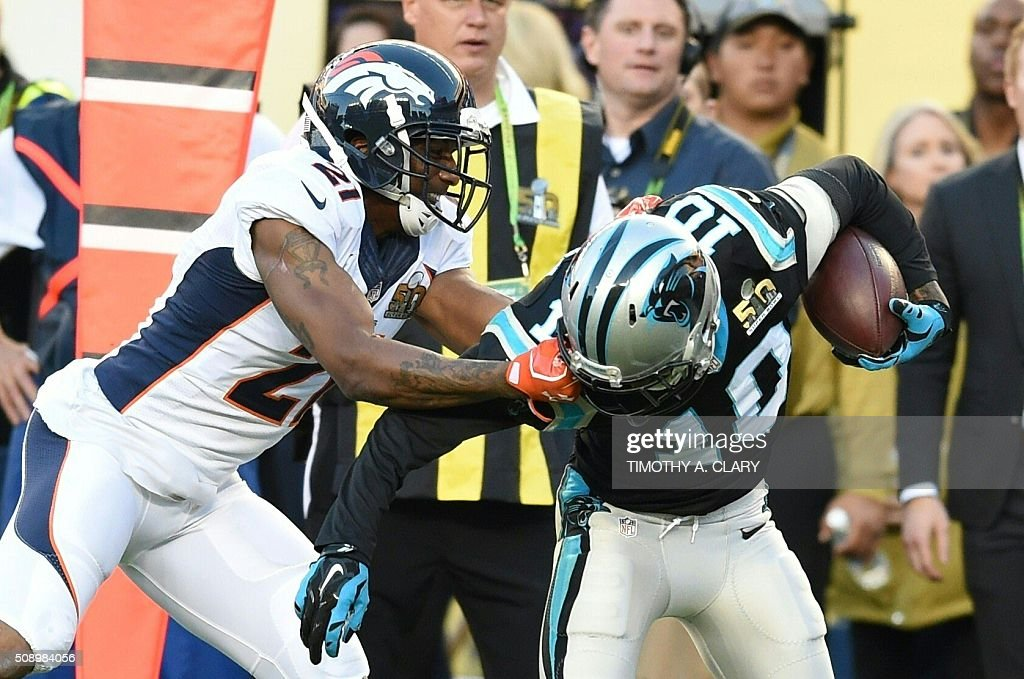 Carolina Panther Philly Brown (10) is fouled by Denver Bronco Aqib Talib(21) during Super Bowl 50 at Levi's Stadium in Santa Clara, California, on February 7, 2016. / AFP / TIMOTHY A. CLARY