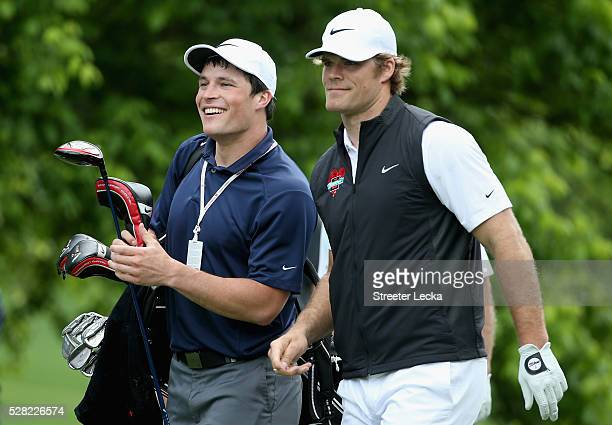 Carolina Panther player Luke Kuechly caddies for teammate Greg Olsen in the proam ahead of the 2016 Wells Fargo Championship at Quail Hollow Club on...