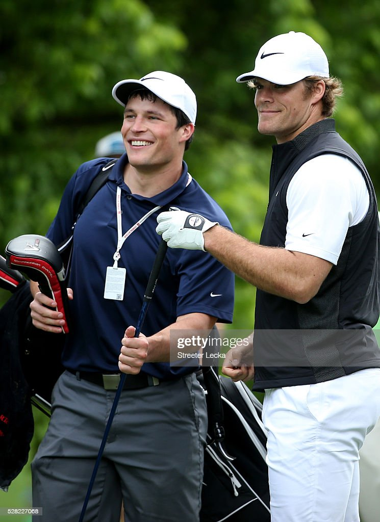 Carolina Panther player Luke Kuechly caddies for teammate Greg Olsen in the pro-am ahead of the 2016 Wells Fargo Championship at Quail Hollow Club on May 11, 2016 in Charlotte, North Carolina.