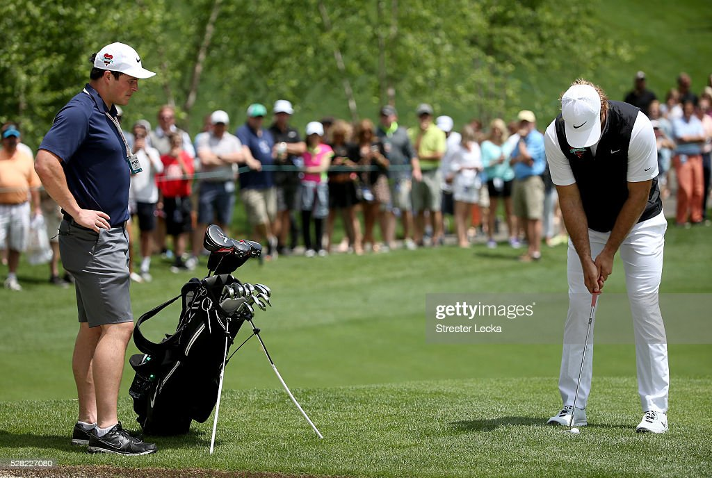 Carolina Panther player <a gi-track='captionPersonalityLinkClicked' href=/galleries/search?phrase=Luke+Kuechly&family=editorial&specificpeople=6234948 ng-click='$event.stopPropagation()'>Luke Kuechly</a> caddies for teammate <a gi-track='captionPersonalityLinkClicked' href=/galleries/search?phrase=Greg+Olsen&family=editorial&specificpeople=2166920 ng-click='$event.stopPropagation()'>Greg Olsen</a> in the pro-am ahead of the 2016 Wells Fargo Championship at Quail Hollow Club on May 11, 2016 in Charlotte, North Carolina.