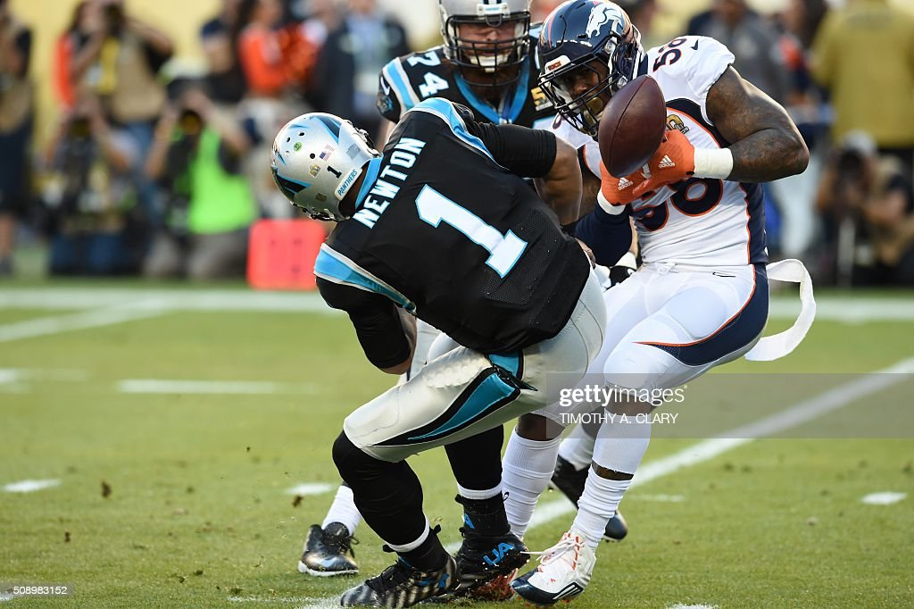 Carolina Panther quarterback Cam Newton loses the ball to Denver Bronco Von Miller during Super Bowl 50 at Levi's Stadium in Santa Clara, California, on February 7, 2016. / AFP / TIMOTHY A. CLARY