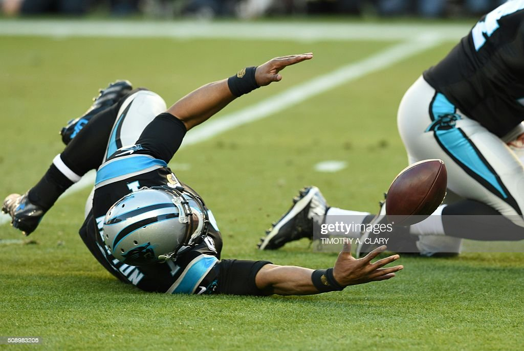 Carolina Panther quarterback Cam Newton reaches for a lose ball cduring Super Bowl 50 against the Denver Broncos at Levi's Stadium in Santa Clara, California, on February 7, 2016. / AFP / TIMOTHY A. CLARY