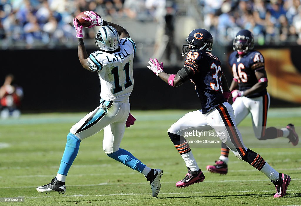 Carolina Panthers' Brandon LaFell (11) reaches up for a reception as Chicago Bears' Charles Tillman (33) defends during the 3rd quarter at Bank of America Stadium in Charlotte, North Carolina, Sunday, October 10, 2010.