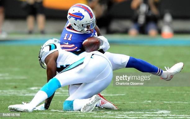Carolina Panthers cornerback James Bradberry dislodges the ball from Buffalo Bills wide receiver Zay Jones in the second half on Sunday Sept 17 2017...