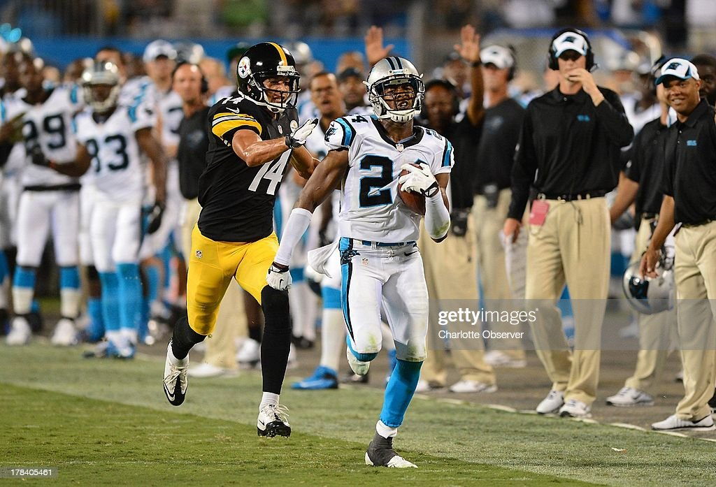 Carolina Panthers cornerback Josh Norman (24) tries to outrun Pittsburgh Steelers wide receiver Derek Moye (14) after intercepting a pass during third-quarter action of a preseason game at Bank of America Stadium in Charlotte, North Carolina, Thursday, August 29, 2013.