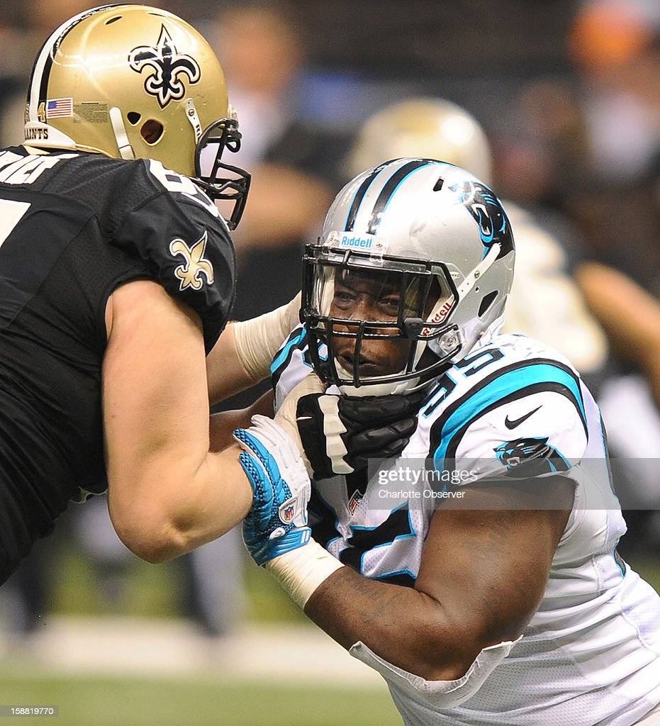Carolina Panthers defensive end Charles Johnson (95) battles to rush the quarterback against New Orleans Saints (64) tackle Zach Strief in the third quarter at the Mercedes-Benz Superdome in New Orleans, Louisiana, Sunday, December 30, 2012. The Panthers defeated the Saints, 44-38.