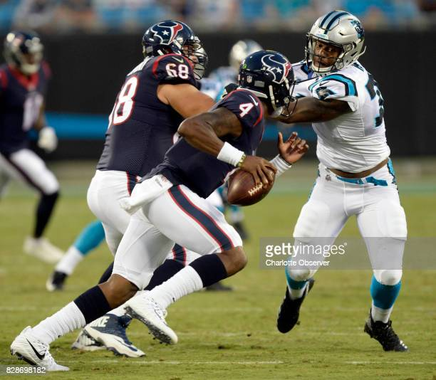 Carolina Panthers defensive end Daeshon Hall pressures Houston Texans quarterback Deshaun Watson in the first half at Bank of America Stadium on...