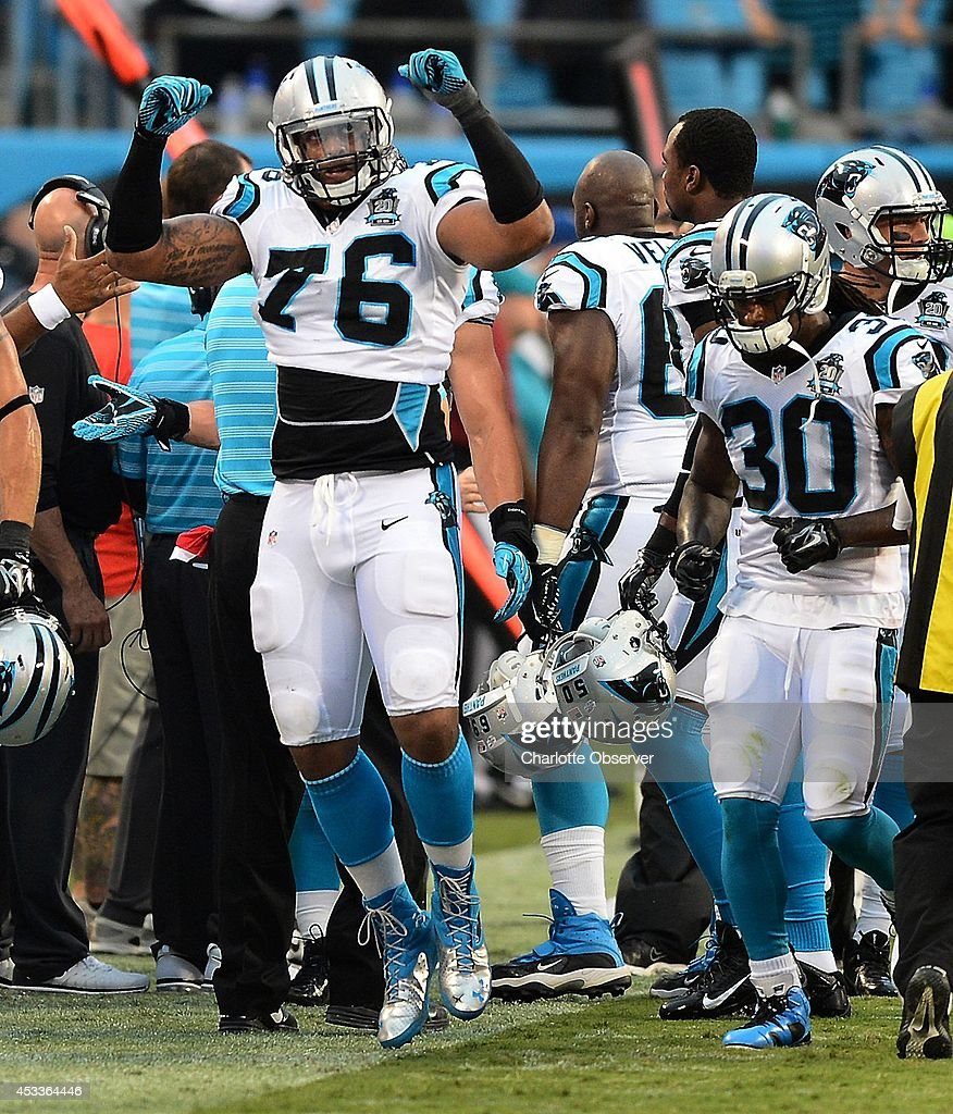Carolina Panthers defensive end Greg Hardy (76) flexes his arms as he runs back to the team's sideline after he and the defense stopped the Buffalo Bills' offense at the goal line during the first quarter at Bank of America Stadium in Charlotte, N.C., on Friday, Aug. 8, 2014. The Bills defeated the Panthers, 20-18.