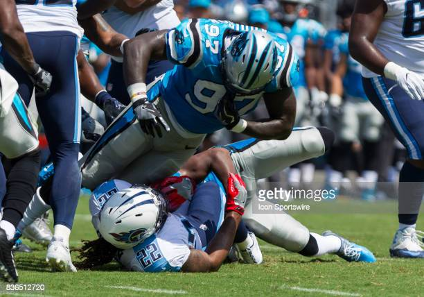 Carolina Panthers defensive end Mario Addison dives on top of Tennessee Titans running back Derrick Henry during the preseason NFL game between the...