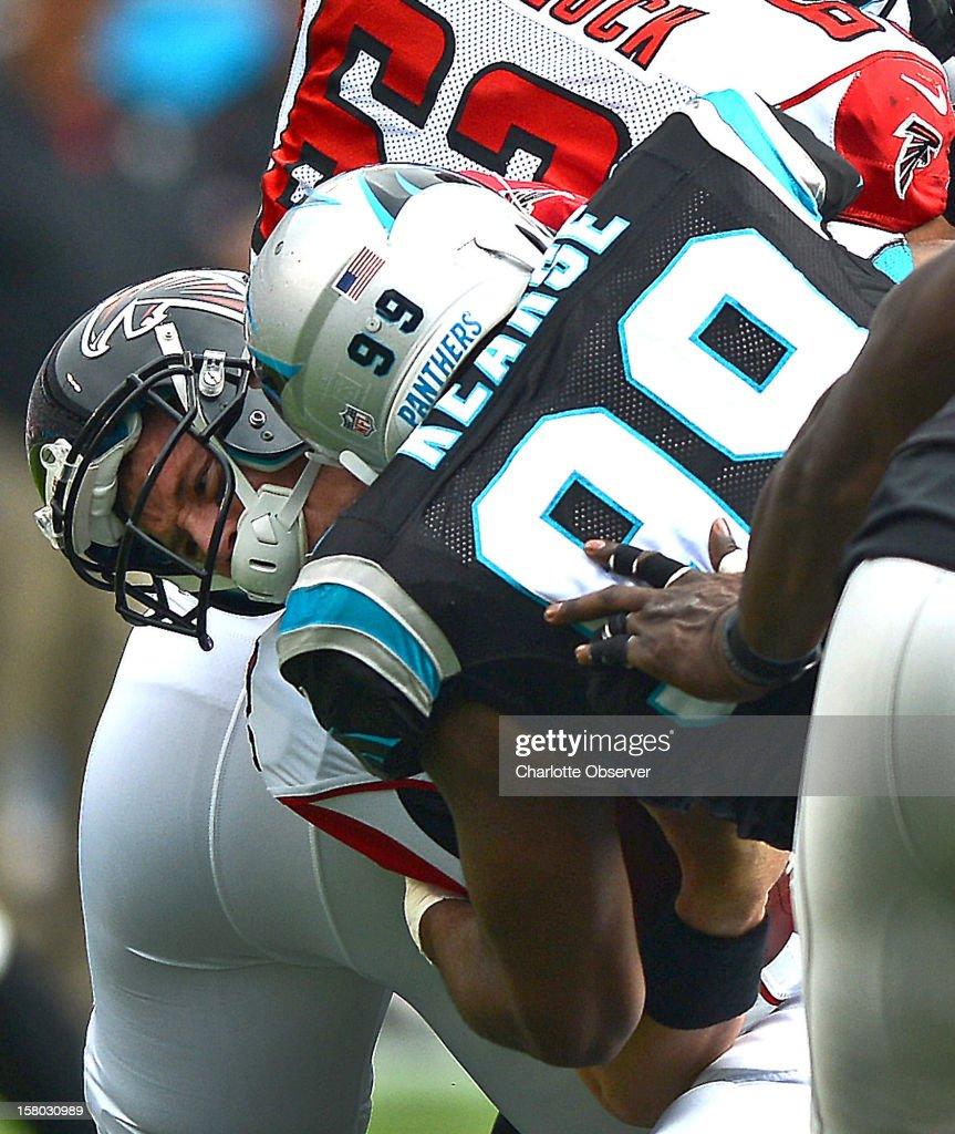 Carolina Panthers defensive tackle Frank Kearse sacks Atlanta Falcons quarterback Matt Ryan during first-quarter action at Bank of America Stadium on Sunday, December 9, 2012, in Charlotte, North Carolina.