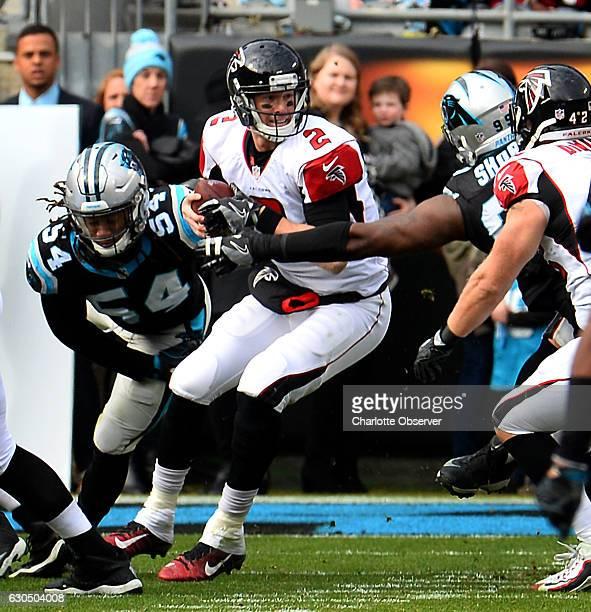 Carolina Panthers defensive tackle Kawann Short right and linebacker Shaq Thompson left pressure Atlanta Falcons quarterback Matt Ryan center during...