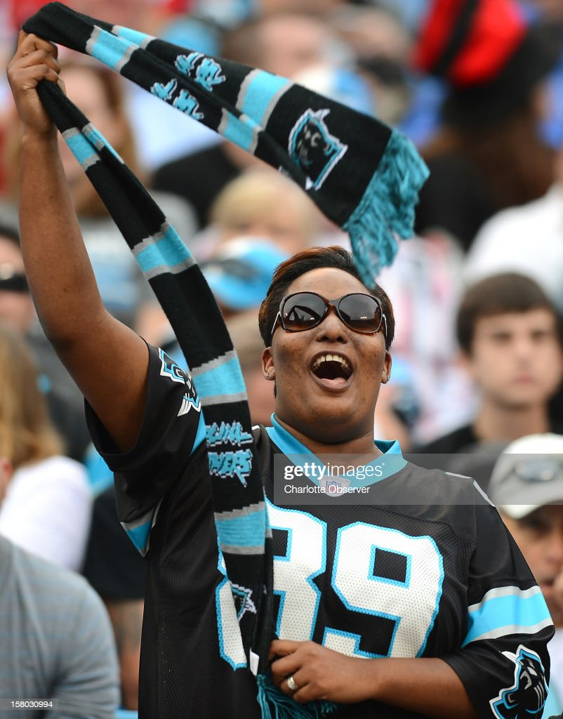 A Carolina Panthers fan cheers on the team during second-quarter action against the Atlanta Falcons at Bank of America Stadium on Sunday, December 9, 2012, in Charlotte, North Carolina.