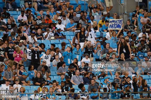 Carolina Panthers fans cheer the team during Fan Fest at Bank of America Stadium in Charlotte NC on Friday Aug 4 2017