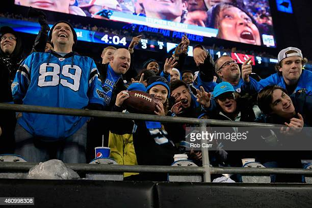 Carolina Panthers fans react after being given a game ball after the NFC Wild Card Playoff game at Bank of America Stadium on January 3 2015 in...