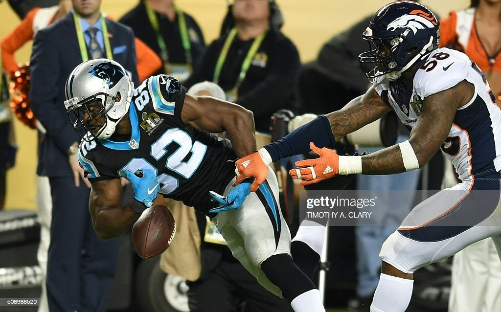 Carolina Panthers Jerricho Cotchery loses the ball as he is defended by Denver Bronco Von Miller during Super Bowl 50 at Levi's Stadium in Santa Clara, California, on February 7, 2016. / AFP / TIMOTHY A. CLARY