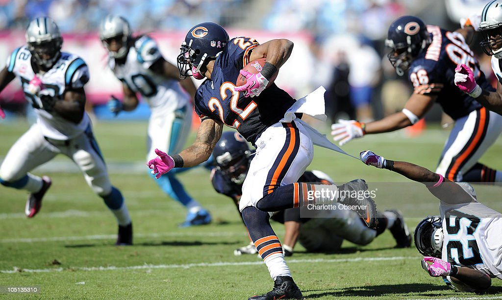 Carolina Panthers' Jordan Pugh (29) reaches for Chicago Bears' Matt Forte (22) during the 3rd quarter at Bank of America Stadium in Charlotte, North Carolina, Sunday, October 10, 2010.
