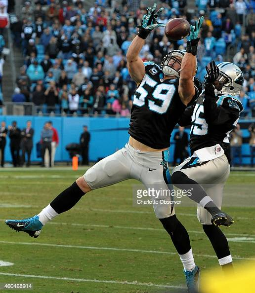 Carolina Panthers linebacker Luke Kuechly intercepts a pass by Tampa Bay Buccaneers quarterback Josh McCown with 14 seconds left in the fourth...