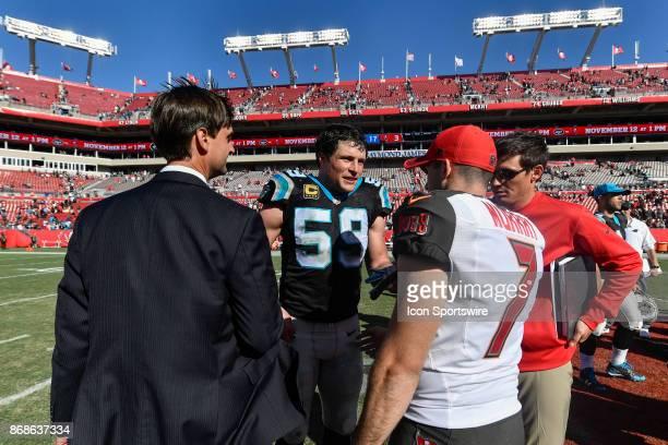 Carolina Panthers linebacker Luke Kuechly meets Tampa Bay Buccaneers kicker Patrick Murray after an NFL football game between the Carolina Panthers...