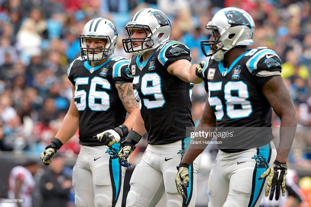 Carolina Panthers linebackers AJ Klein Luke Kuechly and Thomas Davis approach the line against the Atlanta Falcons in the 3rd quarter during their...