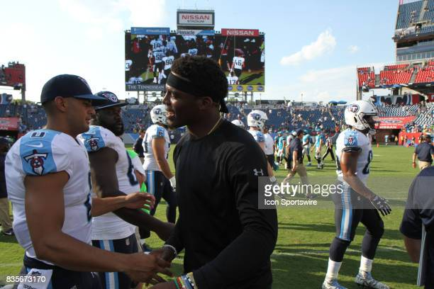 Carolina Panthers quarterback Cam Newton and Tennessee Titans quarterback Marcus Mariota shake hands after a preseason game on August 19 at Nissan...