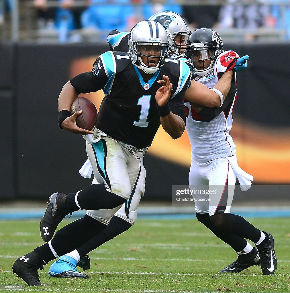 Carolina Panthers quarterback Cam Newton breaks into the open field for a 72-yard touchdown run against the Atlanta Falcons during third-quarter action at Bank of America Stadium on Sunday, December 9, 2012, in Charlotte, North Carolina.