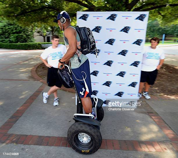 Carolina Panthers quarterback Cam Newton breezes past the backdrop where head coach Ron Rivera will speak on the campus of Wofford College in...