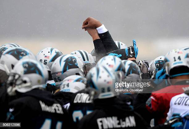 Carolina Panthers quarterback Cam Newton brings the players together in a huddle prior to the start of practice on Friday Jan 22 in Charlotte NC with...