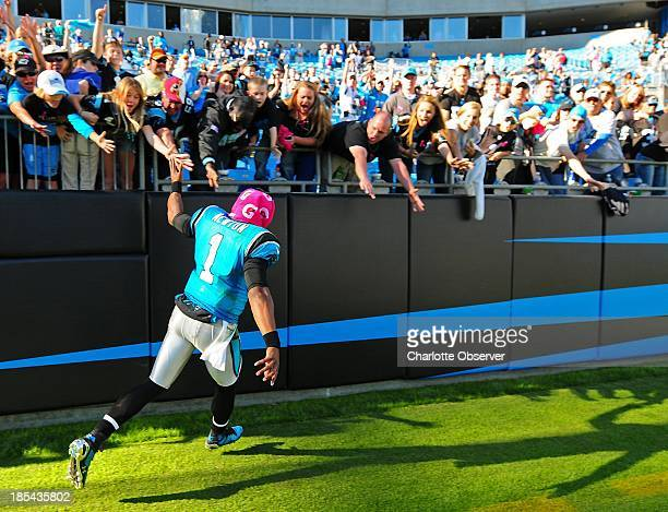 Carolina Panthers quarterback Cam Newton celebrates the team's victory over the St Louis Rams at Bank of America Stadium in Charlotte North Carolina...