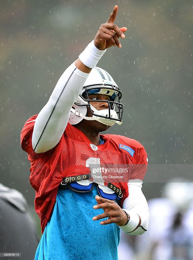 Carolina Panthers quarterback Cam Newton (1) directs the offense during practice at Wofford College on Thursday, July 31, 2014, in Spartanburg, S.C.