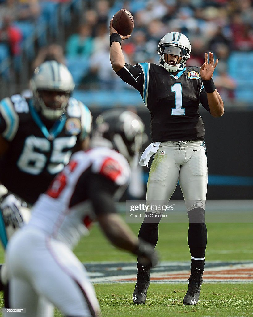 Carolina Panthers quarterback Cam Newton drops back to pass during first-quarter action against the Atlanta Falcons at Bank of America Stadium on Sunday, December 9, 2012, in Charlotte, North Carolina.