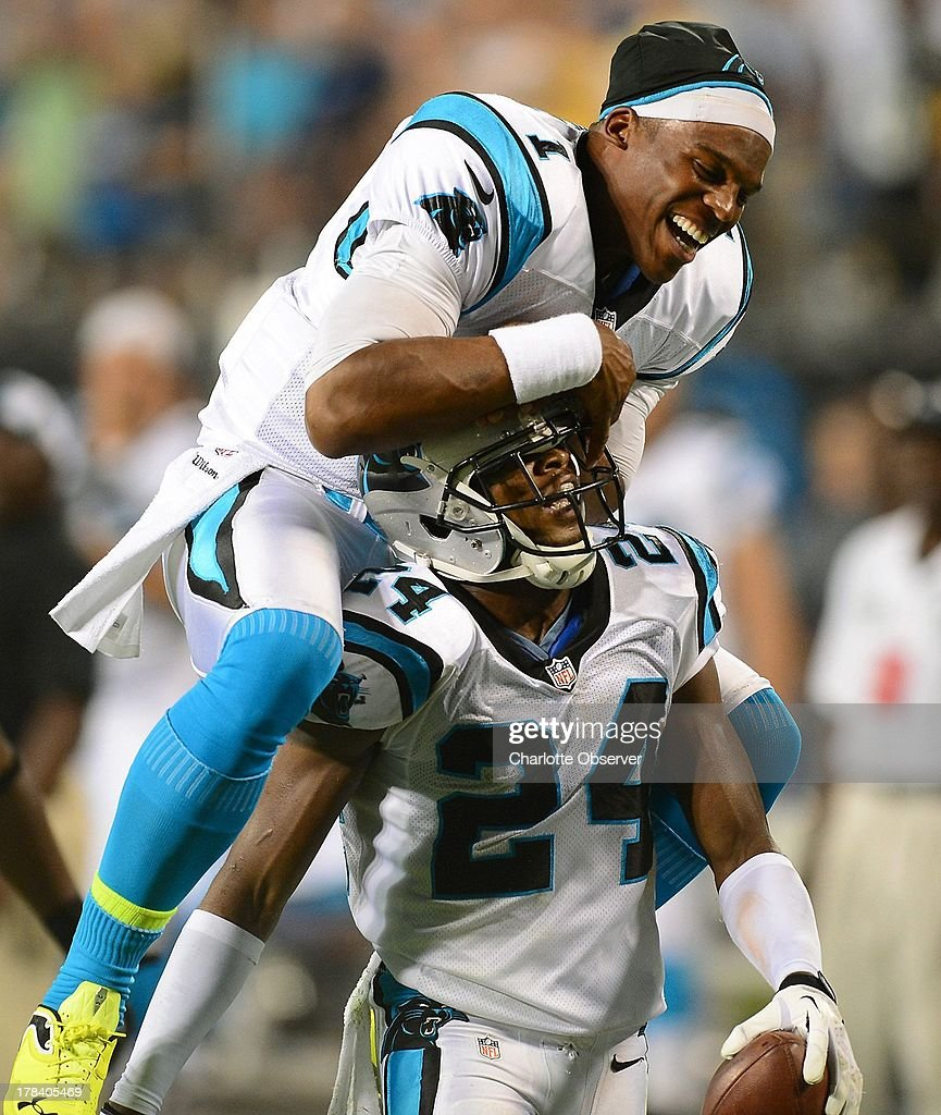 Carolina Panthers quarterback Cam Newton (1) leaps onto cornerback Josh Norman's back, who intercepted a pass by Pittsburgh Steelers quarterback Landry Jones during third-quarter action of a preseason game at Bank of America Stadium in Charlotte, North Carolina, Thursday, August 29, 2013.