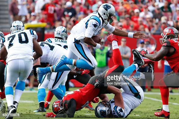 Carolina Panthers quarterback Cam Newton leaps over Tampa Bay Buccaneers defensive end Cliff Matthews well running the ball in the 2nd quarter of the...