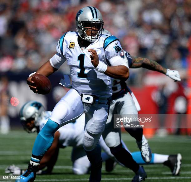 Carolina Panthers quarterback Cam Newton looks for room to run during first quarter action against the New England Patriots on Sunday Oct 1 2017 at...