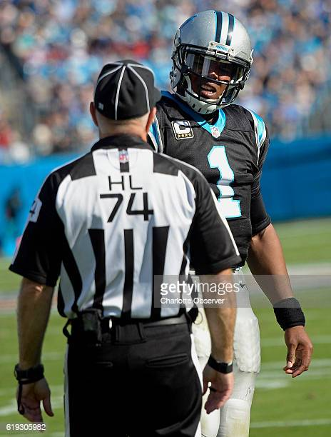 Carolina Panthers quarterback Cam Newton questions head linesman Derick Bowers about a noncall while playing against the Arizona Cardinals in the...