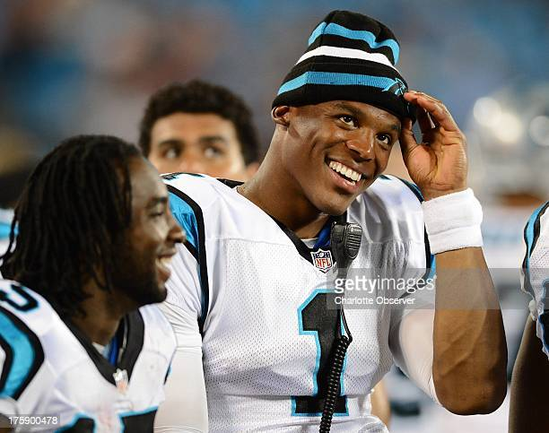 Carolina Panthers quarterback Cam Newton relaxes on the sideline during fourthquarter action against the Chicago Bears in preseason action at Bank of...