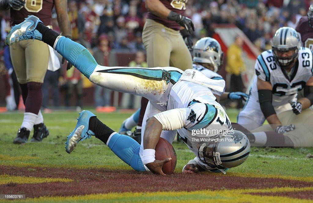 Carolina Panthers quarterback Cam Newton rolls into the endzone to put Carolina up 206 during a game between the Carolina Panthers and the Washington...