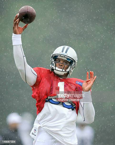 Carolina Panthers quarterback Cam Newton runs through a passing drill on Tuesday July 31 2012 at Wofford College in Spartanburg South Carolina Rain...