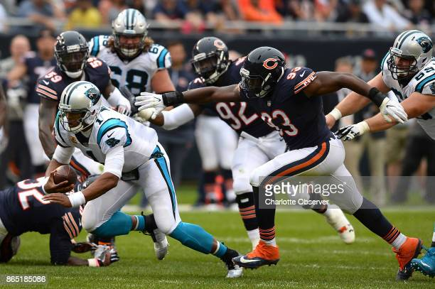 Carolina Panthers quarterback Cam Newton rushes for yardage and looks to dive as the Chicago Bears defense attempts to make a tackle during third...