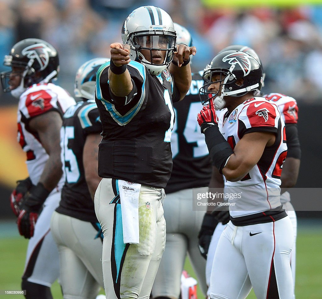 Carolina Panthers quarterback Cam Newton signals first down following his run against the Atlanta Falcons at Bank of America Stadium on Sunday, December 9, 2012, in Charlotte, North Carolina.