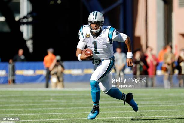 Carolina Panthers quarterback Cam Newton takes off with the ball during a game between the New England Patriots and the Carolina Panthers on October...